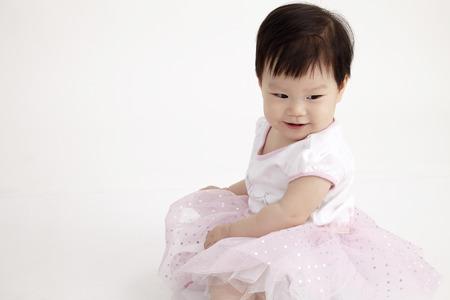 Photo pour portrait of chinese baby girl looking down - image libre de droit
