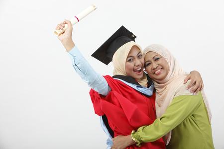 Foto de Young woman with her mother on graduation day - Imagen libre de derechos
