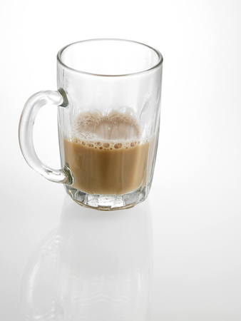 Foto de Half glass of Tea with milk or Teh Tarik in Malaysia - Imagen libre de derechos