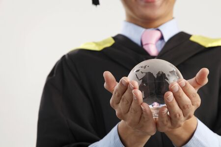 Photo for mid section of the man holding glass globe - Royalty Free Image