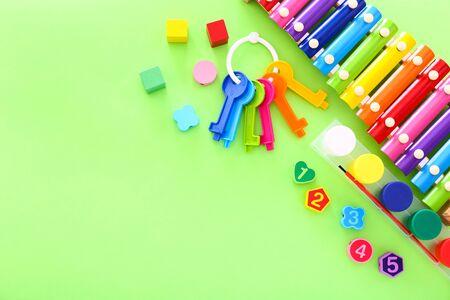 Photo pour Colorful kids toys on green background. Top view - image libre de droit