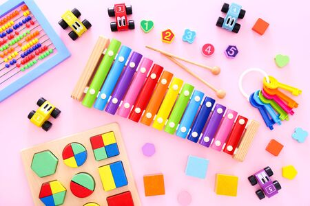 Photo for Colorful kids toys on pink background. Top view - Royalty Free Image
