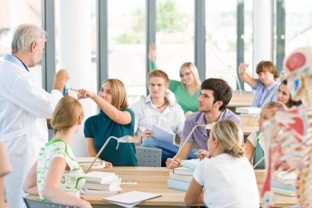 Photo pour Group of medicine students with professor having anatomy class - image libre de droit