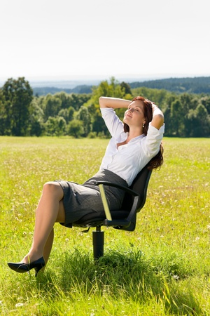 Young businesswoman sunny meadow relax on armchair attractive nature