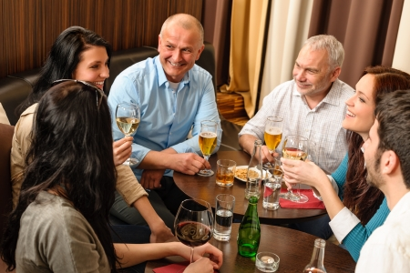 Drink after work happy colleagues having fun at fancy restaurant