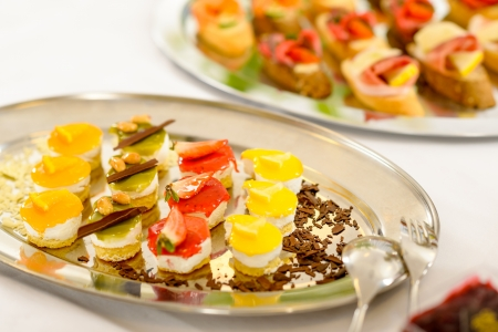 Appetizers mini desserts on catering buffet white tablecloth