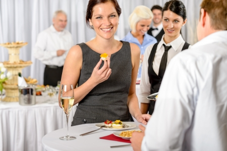 Business woman eat dessert from catering service during company meeting