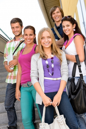 Students back to school on college stairs teens standing smiling