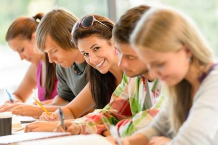 Photo pour Students writing at high-school exam teens study campus academic class - image libre de droit