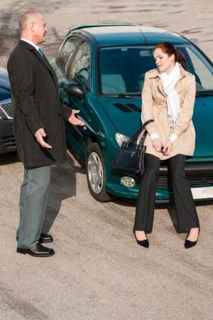 Man and woman talking after car crash sad guilt problem