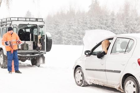 Winter car assistance man help woman breakdown snow road problem