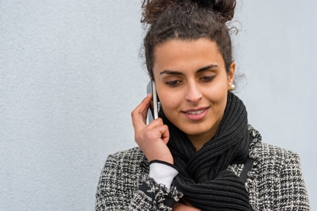 Smiling woman talking on the mobile phone