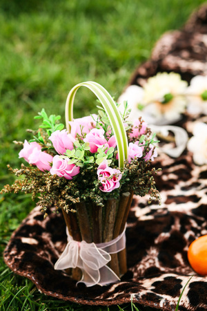 Photo for Bouquet of roses in the basket.Spring picnic - Royalty Free Image
