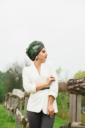 Photo pour portrait of a girl with a scarf on her head in nature - image libre de droit