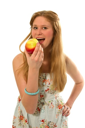 young girl holding a nice juicy apple