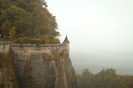 fortress Königstein. autumn fog and the mountain with the castle.