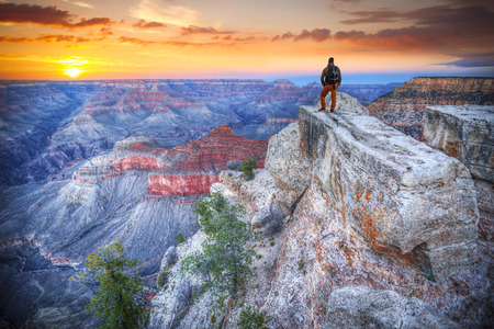 man in the Grand Canyon at sunrise. tourist in America