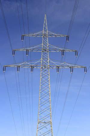 Photo for Electricity pylon in the blue sky. Energy transition environment. Symbol for electricity and energy transition. - Royalty Free Image