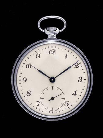 Foto de Retro pocket watch isolated on black background. Front view - Imagen libre de derechos