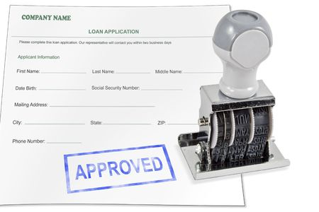 Isolated white background loan application approved rubber stamp for office supply.