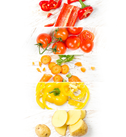 Top view of colorful mix stripes with cut vegetables on white wooden desk; healthy eating concept; yellow, orange, red colors; white space for text
