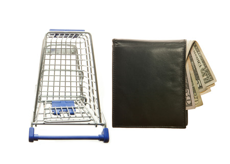 Shopping cart and black leather wallet with Dollars