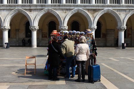 Typical souvenir stand in Piazza San Marco, offering a wide variety of traditional Venetian symbolic goods