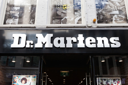 Dr.Martens logo and store front. Dr. Martens is a British footwear and clothing brand, which also makes a range of accessories