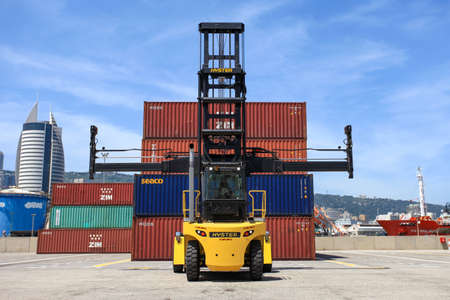 Photo for Hyster container handler lifting a Shipping Container. - Royalty Free Image