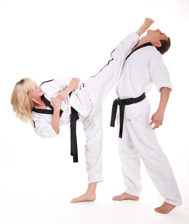 Two people in kimono fight on white background