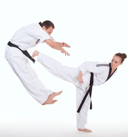 Woman in kimono strikes attacker with foot on white