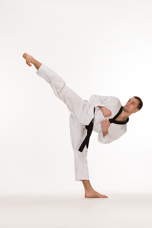 Fighter show foot kick on white