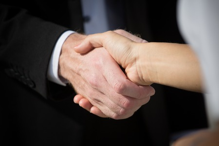 Foto für Business handshake and business people. Business handshake for closing the deal after singing the lucrative contract between companies. - Lizenzfreies Bild