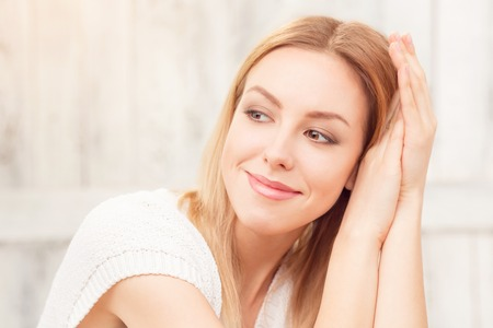 Photo for Portrait of young lady looking away and thinking about something special. Happy lady resting and smiling. - Royalty Free Image