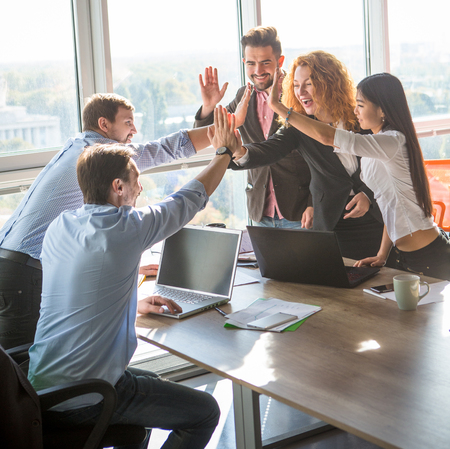 Foto für Business people giving five to their colleague after dealing with foreign partners and signing contract or agreement between companies, enterprises or firms. Teamwork concept. - Lizenzfreies Bild