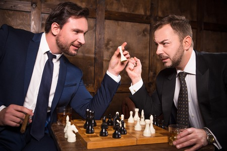 Rich businessmen playing chess
