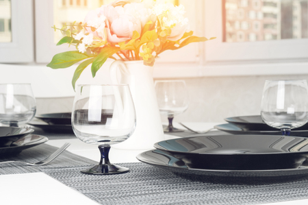 Photo for Kitchen white table served with plates, forks and glasses - Royalty Free Image