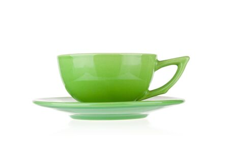 Photo pour Green teacup with saucer isolated on white background - image libre de droit