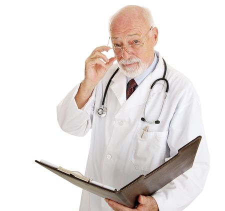 Serious mature doctor wants to discuss your medical history.  Isolated on white.