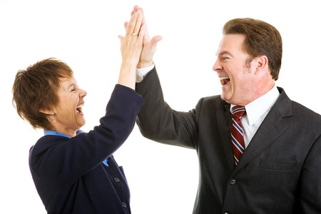 Photo pour Enthusiastic business partners giving each other a high five.  Isolated on white.   - image libre de droit