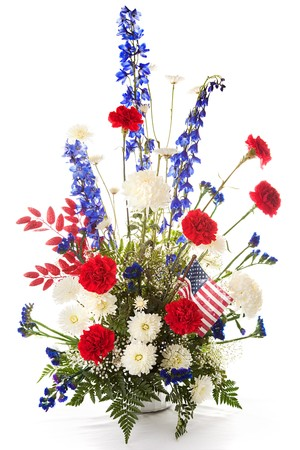 Flower arrangement in red, white, and blue to celebrate America.  Isolated on white.