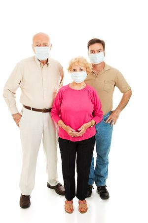 Group of adults wearing face masks and worried about catching the flu.  Full body isolated on white.