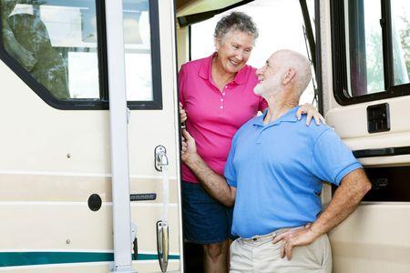 Photo pour Attractive senior couple traveling by motor home. - image libre de droit
