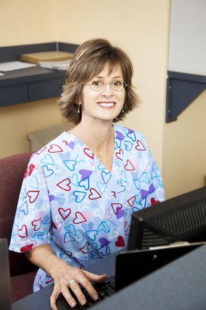 Photo pour Pretty, friendly receptionist in a doctors office.   - image libre de droit