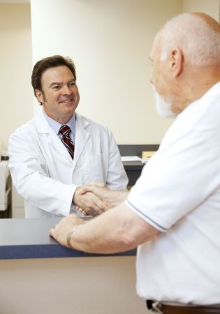 Friendly doctor greeting a new patient at the front desk.