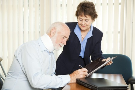 Personal injury lawyer signs up a new injured client.