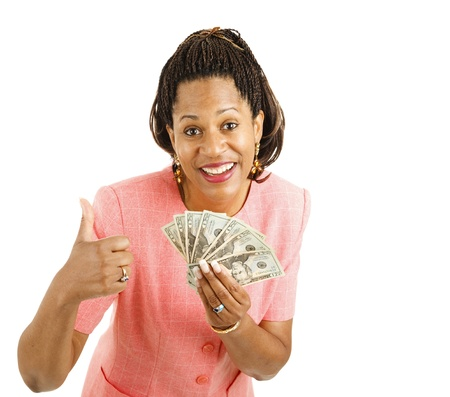 Beautiful African-american businesswoman holding a hand full of cash and giving a thumbsup sign.  Isolated on white