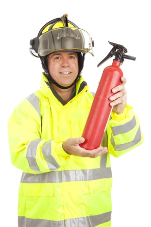 Fire fighter demonstrating how to use a fire extinguisher.  Isolated on white.