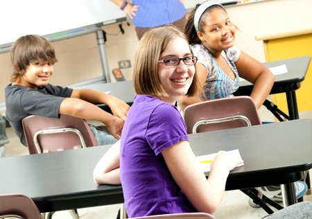Photo pour Happy teenage middle school or highschool students in class.   - image libre de droit