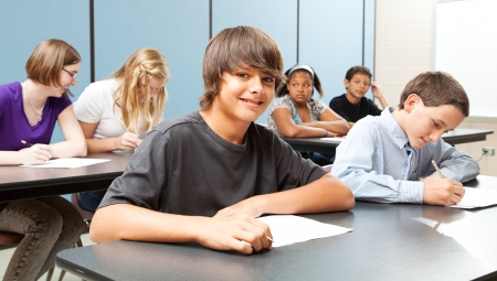 Diverse group of adolescent school children in class.  Real kids in real classroom.